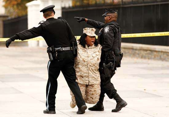 Woman being carried away by police