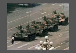 Chinese man facing tanks